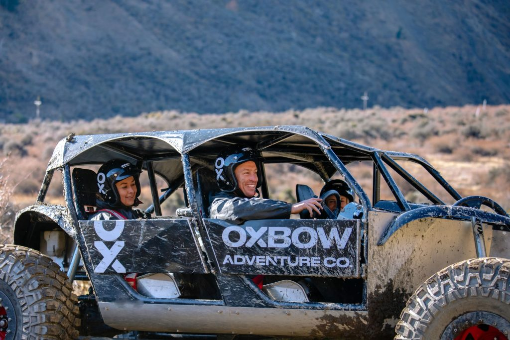 Off-road adventurers with smiles on their faces enjoying a thrilling drive
