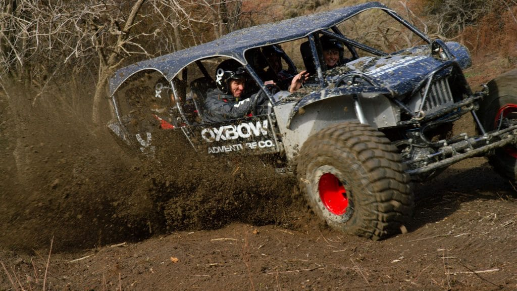 Off-road vehicle in action with happy adventurers driving